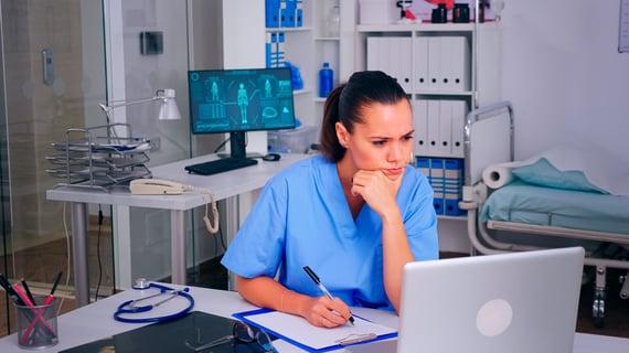 tired-nurse-doctor-putting-off-glasses-resting-eye-GZEVEG8